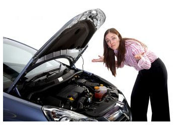 woman-next-to-stalled-car