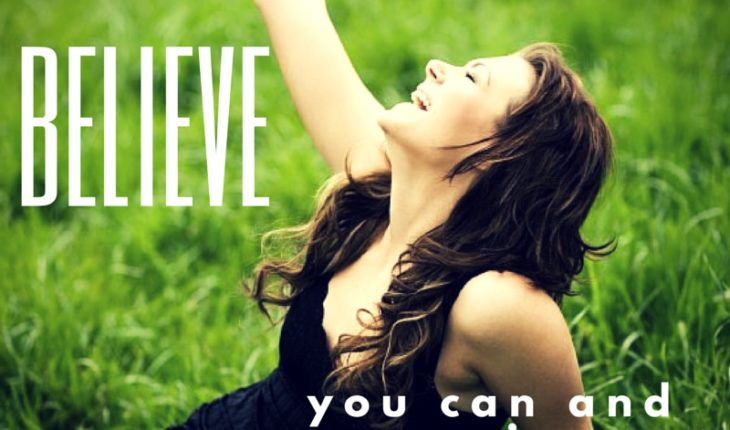 Woman sitting in a Grassy Field - Believe You Can Achieve