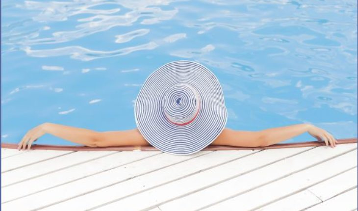 Woman Relaxing by the Pool - Pamper Yourself