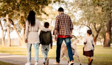 family-walking-in-the-park-during-fall